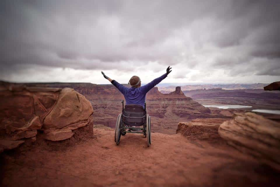 person in wheelchair looking out over the grand canyon
